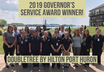 Amber Burch, HTM alumna, and her team receive award
